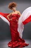 Redheaded Mädchen der Schönheit im Art und Weisekleid Lizenzfreie Stockfotos
