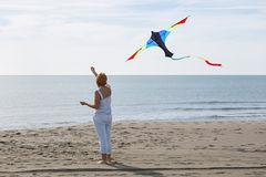 Redheaded model holding kite and posing Royalty Free Stock Photography