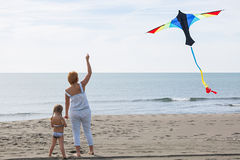Redheaded model holding kite and posing Stock Image