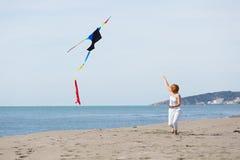 Redheaded model holding kite and posing Stock Photos