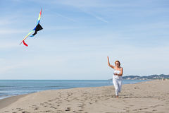 Redheaded model holding kite and posing Royalty Free Stock Photos
