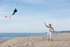 Redheaded model holding kite and posing Stock Photo