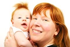 Redheaded mother and baby. Boy smiling on white background stock images