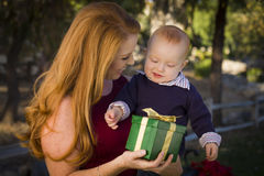 Redheaded Mother and Baby with Christmas Gift Stock Photography