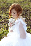 Redheaded princess with a white ferret Royalty Free Stock Images