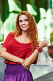 Redheaded smile woman. sunlight city portrait Royalty Free Stock Images