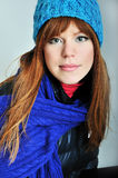 Redheaded winter girl. Wearing blue scarf and hat Stock Image