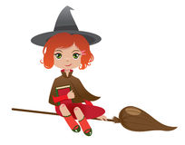 Redheaded witch. With a magicbook flying on her broom Stock Photos