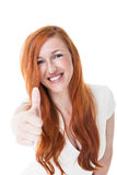 Redheaded woman giving a thumbs up Royalty Free Stock Photo