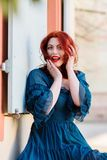 Redheaded woman looks surprised. Portrait of a beautiful redheaded woman who looks surprised Royalty Free Stock Photos