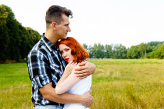 Redheaded woman with man Royalty Free Stock Photography