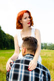 Redheaded woman with man Royalty Free Stock Image