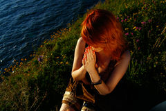 Redheaded woman praying Royalty Free Stock Images