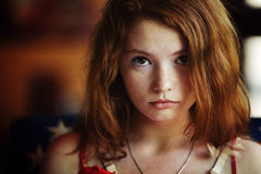 Redheaded woman relaxing in a cafe Royalty Free Stock Photography