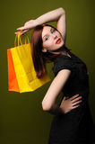 Redheaded Woman With Shopping Bags Royalty Free Stock Photos