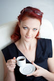 Redheaded woman in the workplace Royalty Free Stock Photo