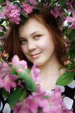 Redheaded young girl. A redheaded young girl is in a spring garden Royalty Free Stock Image