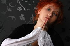 Redheaded young woman. In studio near black wallpaper Stock Photo