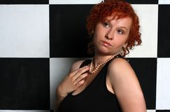 Redheaded young woman. In studio Royalty Free Stock Photo