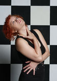 Redheaded young woman. In studio Stock Photo