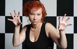 Redheaded young woman. In studio Stock Photos