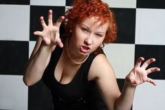 Redheaded young woman. In studio Royalty Free Stock Images