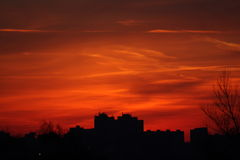 RedHell City. Panel buildings surronded by inferno-like clouds Royalty Free Stock Photography