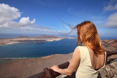 Redhjead woman watching scenery of Lanzarote - panoramic view from Mirador del Rio. Canary islands, la graciosa view royalty free stock photo