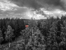 Redhouse in forest royalty free stock photo