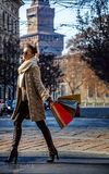 Young woman with shopping bags in Milan, Italy walking Royalty Free Stock Images