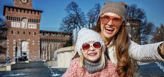 Happy mother and child travellers in Milan, Italy taking selfie Stock Photo