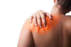 Redish pain. Young woman with sever back pain. She is holding her schoulder. Over white background. The hurting area was saturated in red to symbolize the pain stock photo