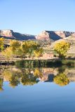 Redlands Mesa Golf Course and Shadow Lake. A golf course community and the cliffs of the Colorado National Monument reflected in an irrigation pond at a local Royalty Free Stock Image