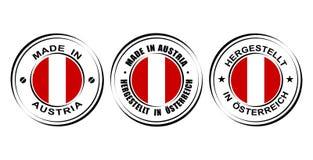 ` Redondo de la etiqueta hecho en el ` de Austria con la bandera Imagen de archivo libre de regalías