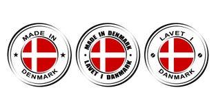 ` Redondo de la etiqueta hecho en el ` de Dinamarca con la bandera Fotografía de archivo
