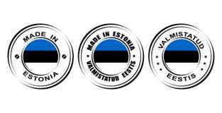 ` Redondo de la etiqueta hecho en el ` de Estonia con la bandera Imagenes de archivo