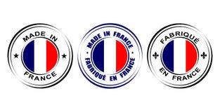 ` Redondo de la etiqueta hecho en el ` de Francia con la flor de lis del símbolo de la bandera y del lirio Imágenes de archivo libres de regalías