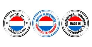 ` Redondo de la etiqueta hecho en el ` de Luxemburgo con la bandera Fotos de archivo