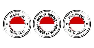 ` Redondo de la etiqueta hecho en el ` de Mónaco con la bandera Fotos de archivo libres de regalías