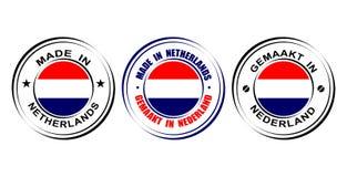 ` Redondo de la etiqueta hecho en ` holandés con la bandera Imagen de archivo libre de regalías