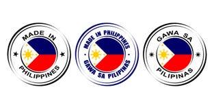 ` Redondo de las etiquetas hecho en el ` de Filipinas con la bandera y el icono de Sun stock de ilustración