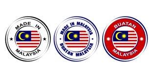 ` Redondo de las etiquetas hecho en el ` de Malasia con la bandera Foto de archivo