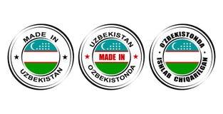 ` Redondo de las etiquetas hecho en el ` de Uzbekistán con la bandera Imagen de archivo