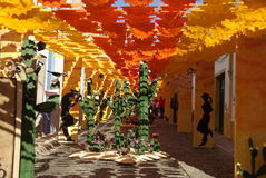 Redondo flower feast. Street decorated with colorful paper flowers in Redondo, Portugal Stock Images