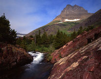 Redrock Falls (H). A horizontal image of Redrock Falls located in Wyoming's Glacier National Park which is part of Waterton-Glacier International Peace Park stock photo