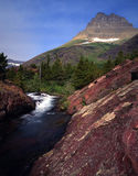 Redrock Falls (V). A vertical image of Redrock Falls located in Wyoming's Glacier National Park which is part of Waterton-Glacier International Peace Park stock image