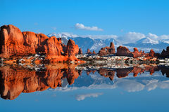 Redrock Reflections. View of the red rock formations in arches national Park with blue sky's and clouds royalty free stock photos