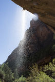 Redrock Sandstone and Waterfall Southern Utah. Redrock sandstone and waterfall at Weeping Rock in Zion National Park in southern Utah royalty free stock image