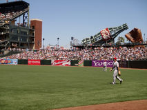 Reds outfield walk to positions between plays Royalty Free Stock Photo