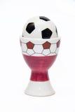 Redskap för salt i form av en fotbollboll Arkivbild